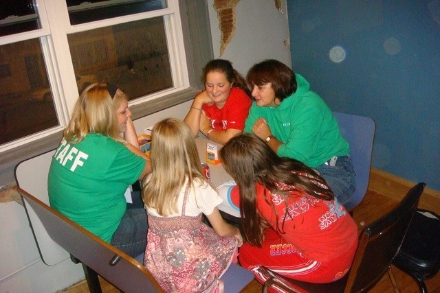 Leaders playing games with the girls