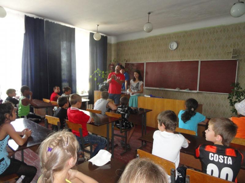 Ronnie teaching kids Bible lesson, camp 2012