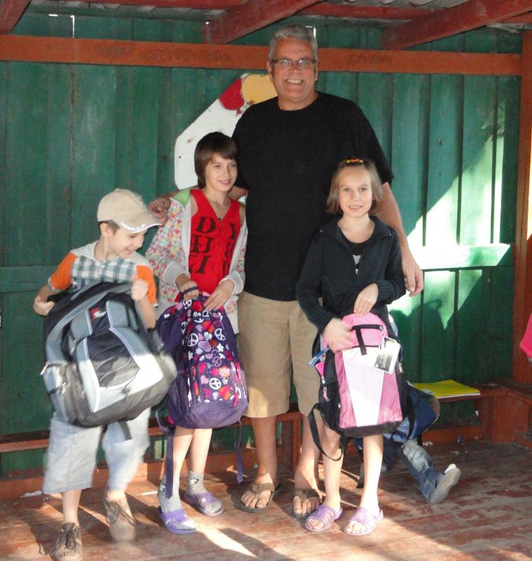 Children  at the local shelter receiving backpacks