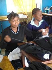 Students learning to sew at Cheleshe School for the handicapped