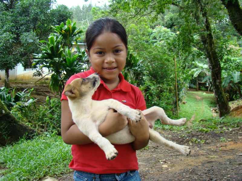 Panamanian girl with puppy