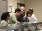 Board of Directors serving meals