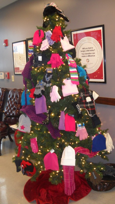 Arkansas Rice Depot's hat, mitten, and scarf tree benefitting our Kids' Coat Project.
