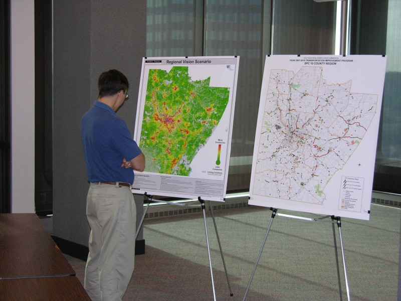 A participant at the SPC Information Forum studies a preferred scenario map for transportation