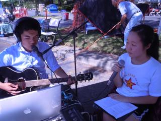 Event chair, Vivien & administrator Steven record a song