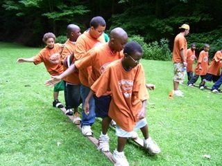 Summer Day Campers practice teamwork.