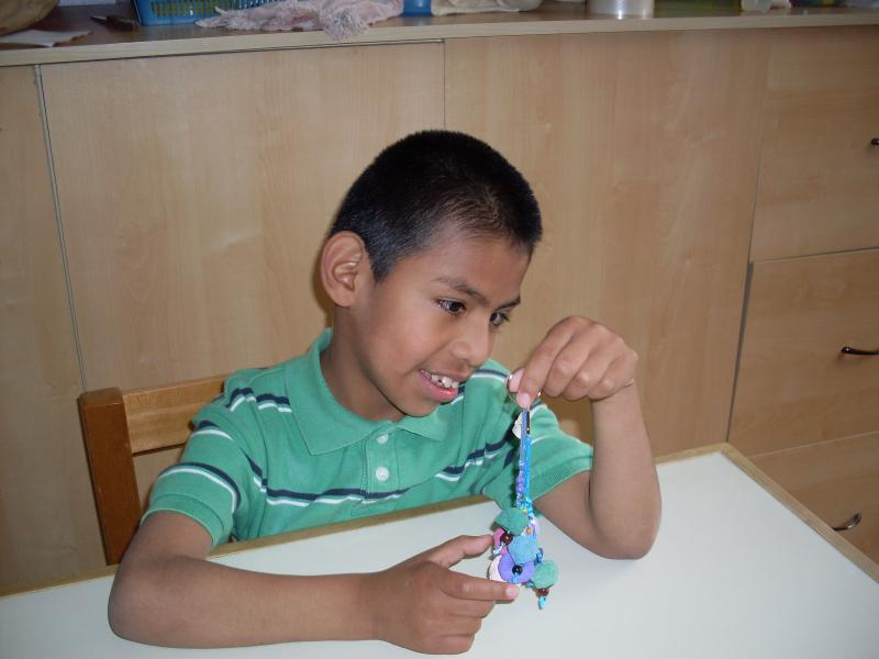 Diego, a special needs child in Guatemala, whose education is funded by World of Children