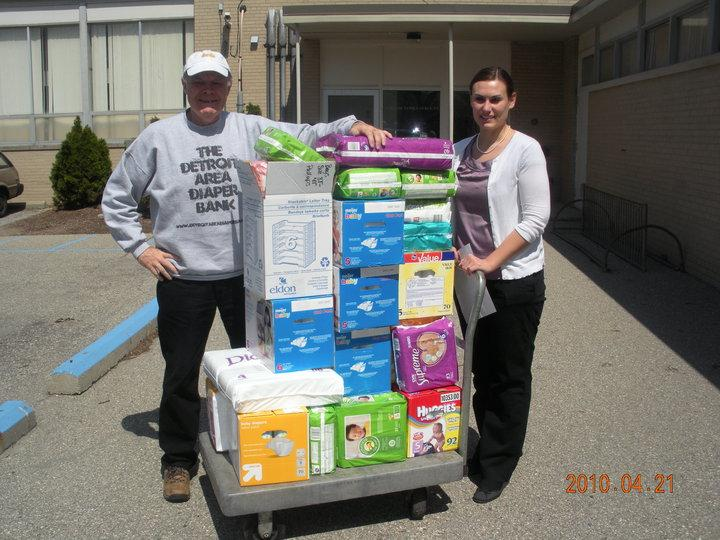 Board Member John Burnham helping deliver a diaper donation to a Wayne County nonprofit