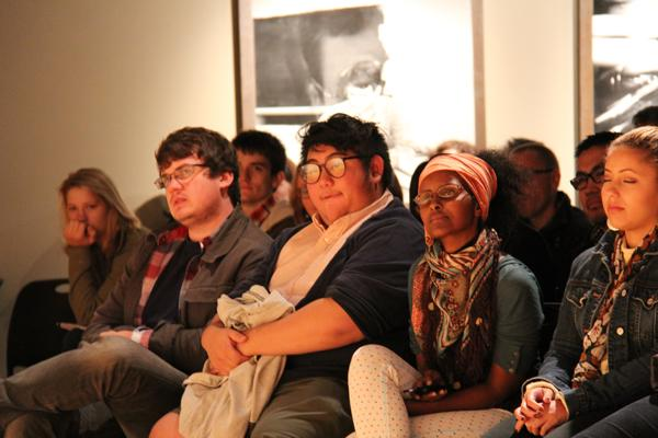 Poet Hieu Minh Nguyen in crowd, ready to perform for the Equilbrium spoken word series.