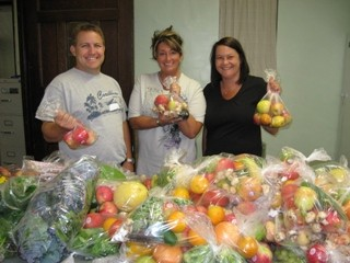 A volunteer group displays the fruits of their labors a the Food Pantry