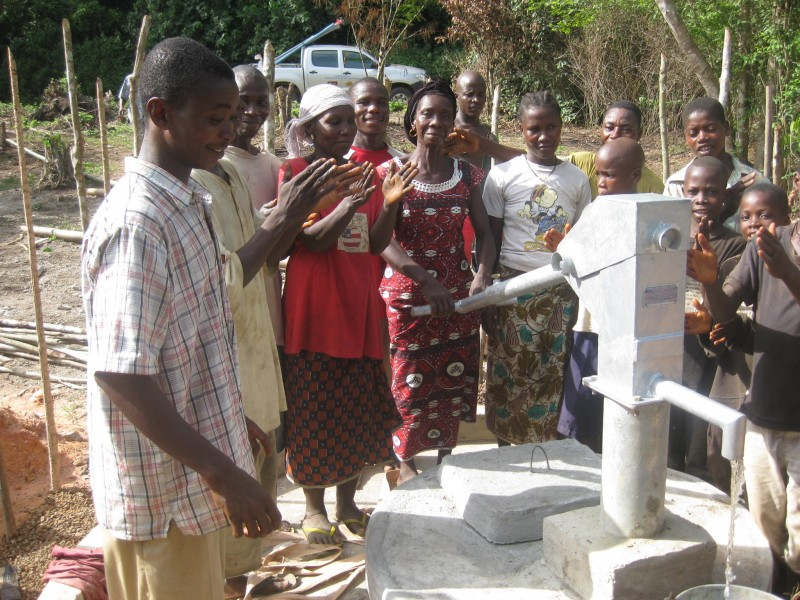The female chief of Kulapa pumps water from one of eight wells built this April and May