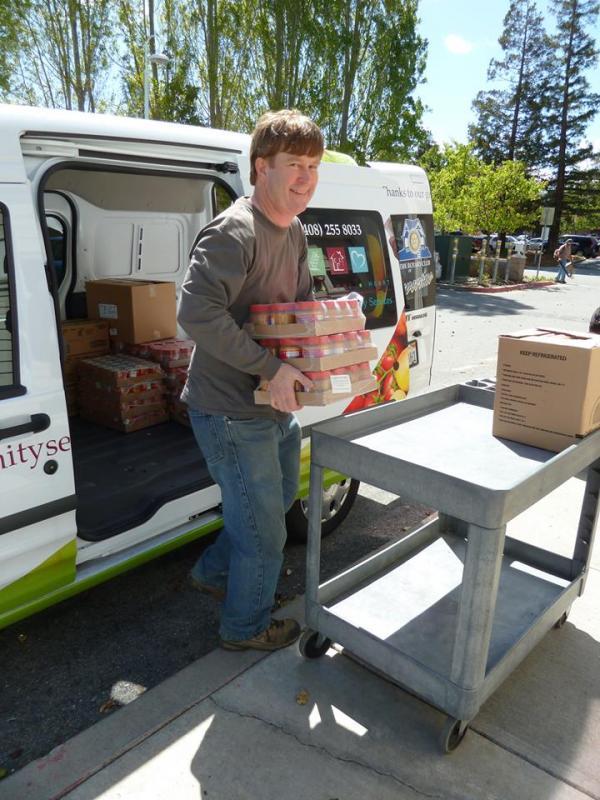 Volunteer unloading food for the food pantry