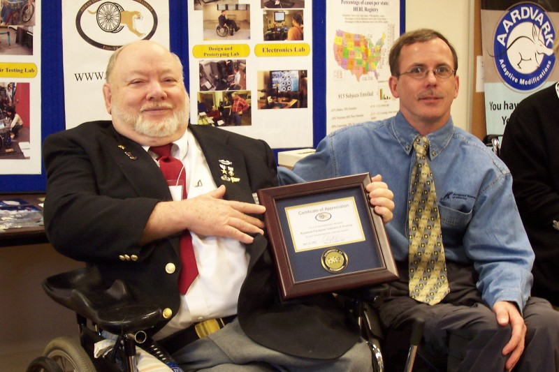 Dr. Rory Cooper (r.) recognized KPVA for supporting wheelchair research (with Pres. Fred Tregaskes)