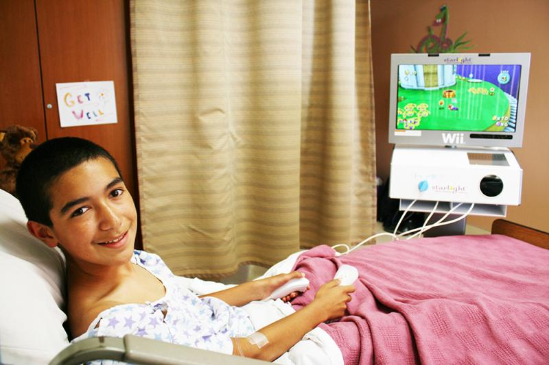 Starlight Fun Center® mobile entertainment unit - Equipped with the latest gaming system that rolls bedside in hospitals, Fun Center units provide distractive entertainment and the healing power of play to pediatric patients.