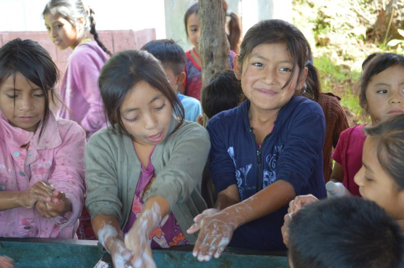 Children at a school in Guatemala practice the four steps of hand washing after attending a presentation by Curamericas Guatemala staff