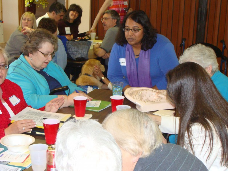 Attendees at an educational event learn about acupuncture and other complementary therapies for PD