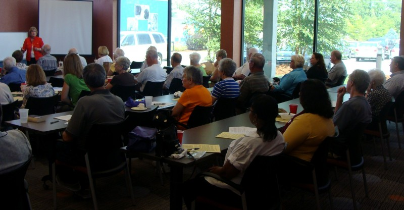 Attendees at an educational event learn about sleep problems and PD