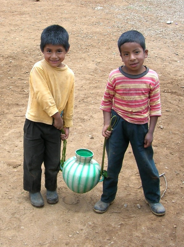 Boys gathering water in Guatemala.