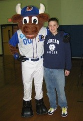 Gabe Titus and Wool E. Bull (Durham Bulls Mascot) at a Childhood Cancer Awareness Day