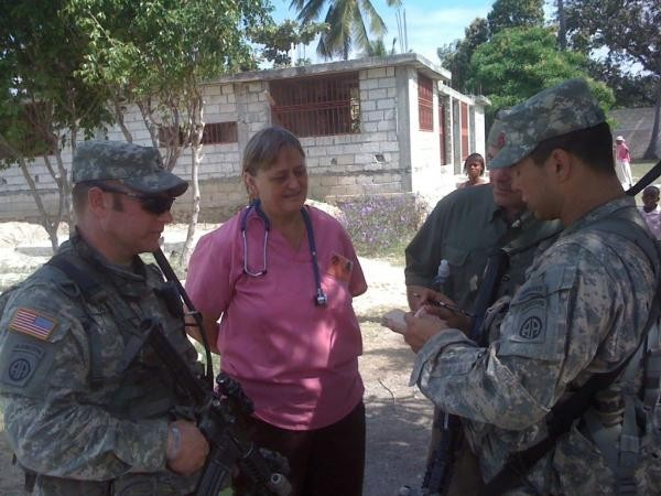 PID President, Gale Hull, meets with UN workers soon after the 2010 earthquake in Haiti.