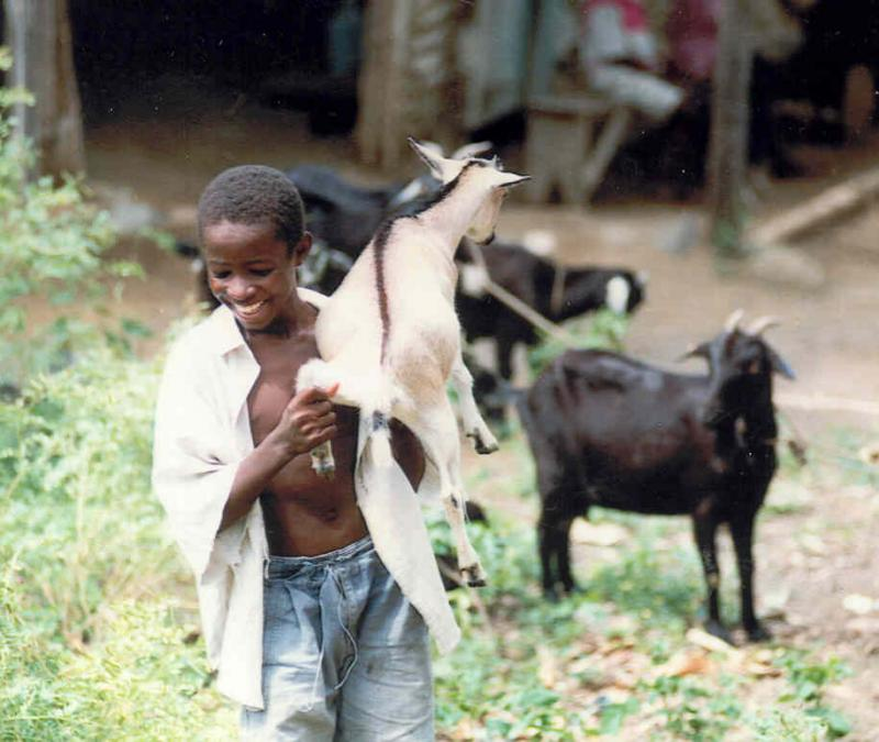 A young goat farmer in Haiti.