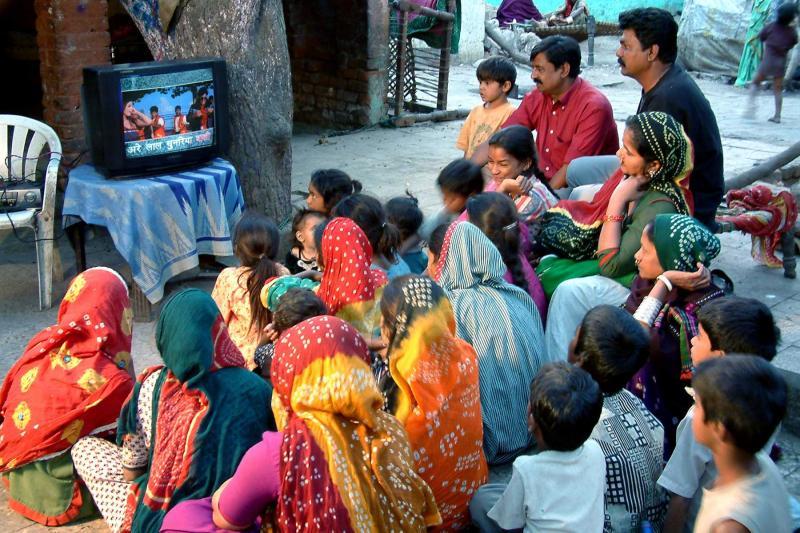 Community viewing of songs with Same Language Subtitling, Gulbai Tekra Slum, Ahmedabad.