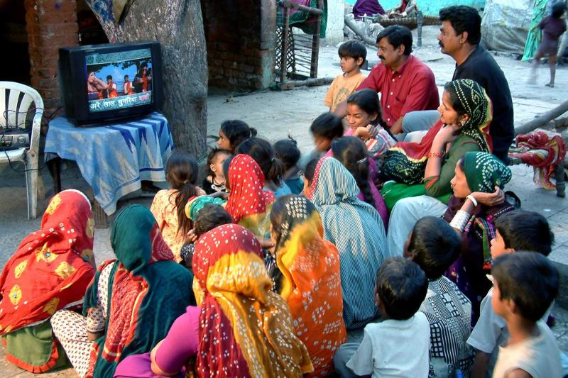 Community viewing of songs with Same Language Subtitling, Gulbai Tekra Slum, Ahmedabad.