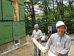 Volunteers from EMC Corporation help build a home for the Anderson family in Hudson, MA