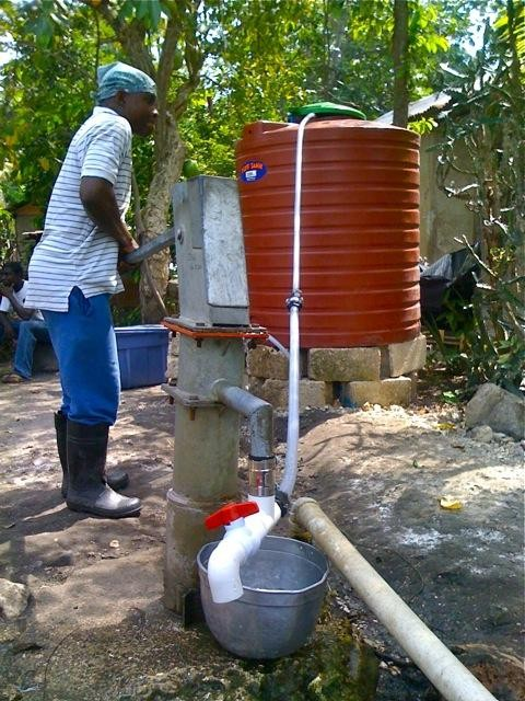 Hand pump in Haiti using EDGE modification making it possible to pump water directly to tank