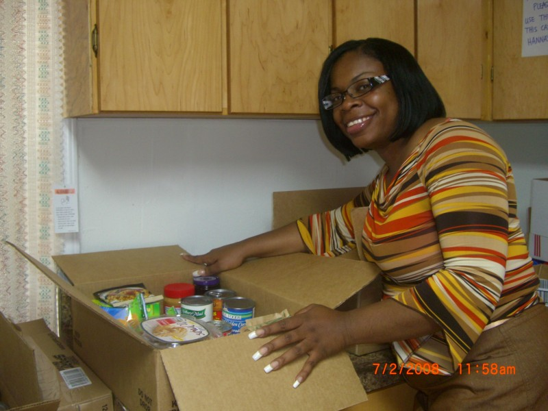 Our CEO preparing food boxes in