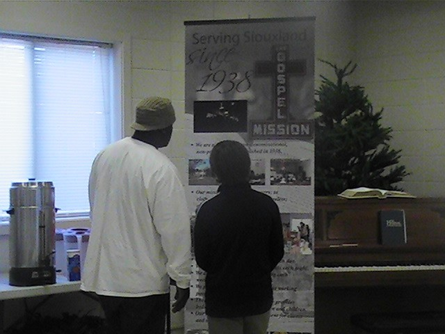 One of our guests explaining our mission to a high schooler