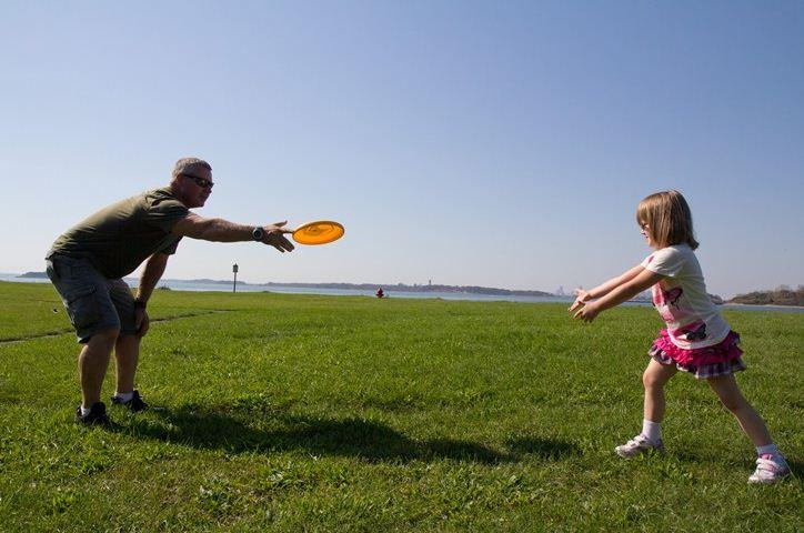 Exoneree Scott Hornoff plays frisbee with another exoneree's daughter at our annual exoneree picnic