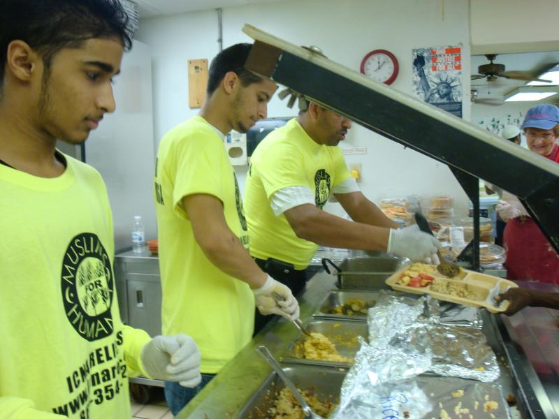 Volunteers are serving warm meal to the needy.