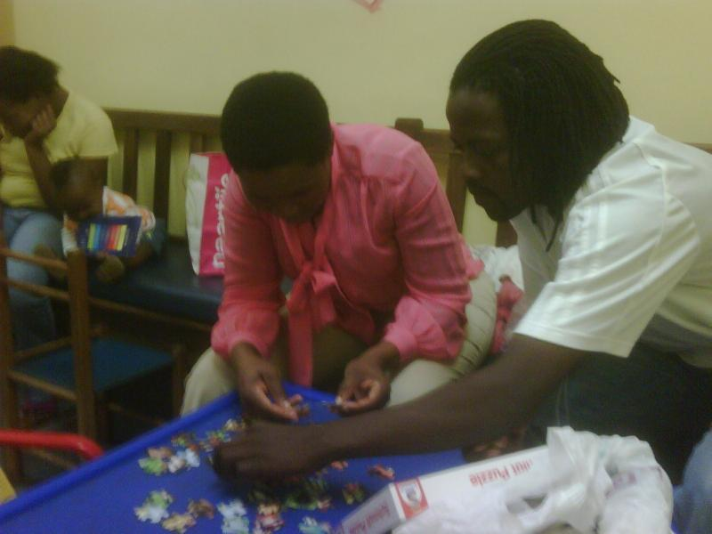 At Clinic Siya helping a Mother with a puzzle