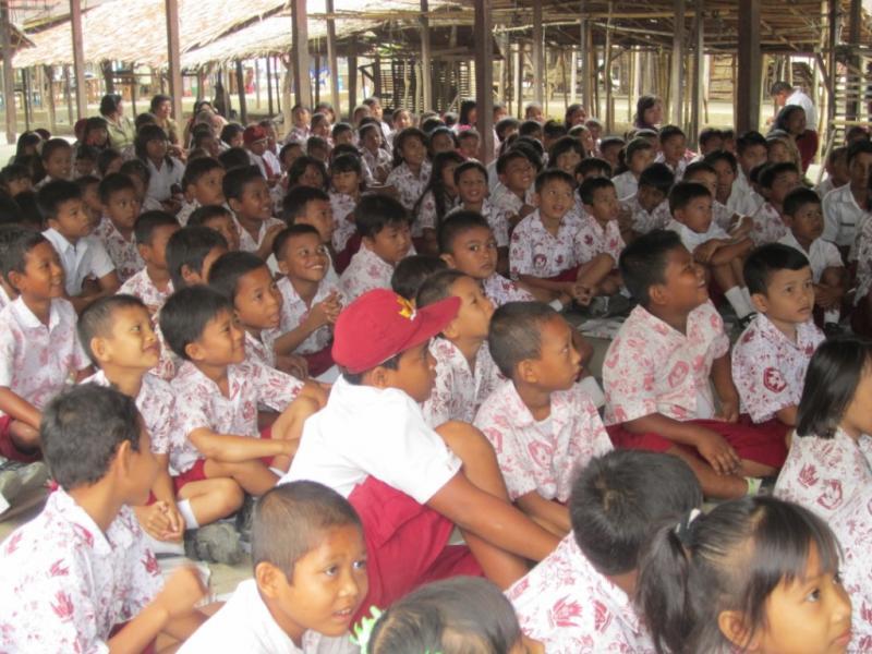 Students in village learning about orangutans during MECU program