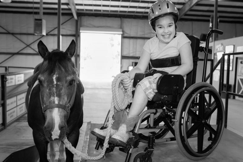 Sasha is ready to get out of her wheelchair and onto her steed,