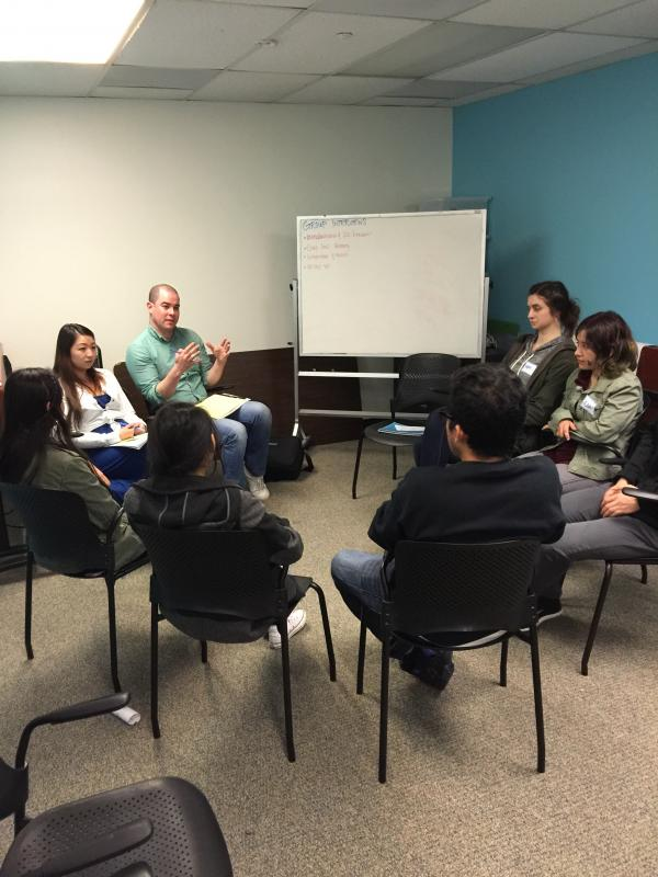 Volunteers from Gap lead a workshop on group interviews with youth.