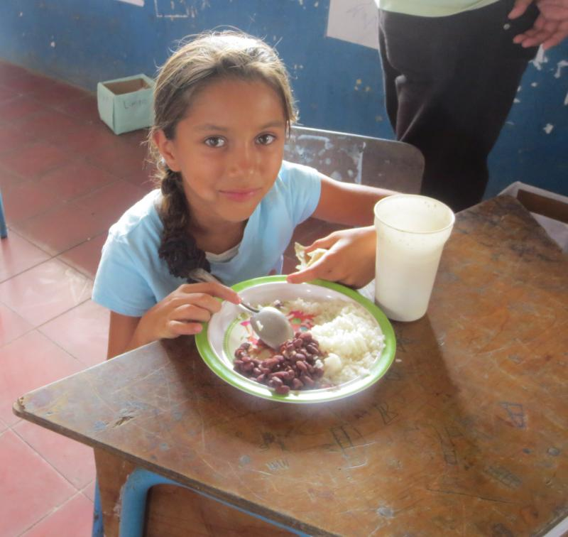 Child Eating in Rainbow Network Feeding Center