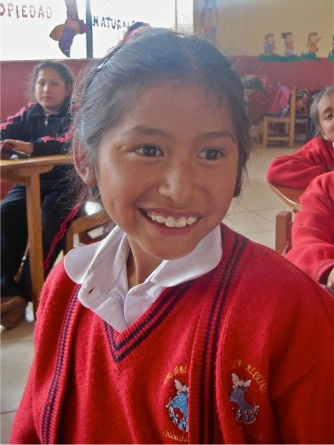 Primary grade school in Cusco is from Kindergarten through 6th grade. This student is radiant and thriving at CW school.