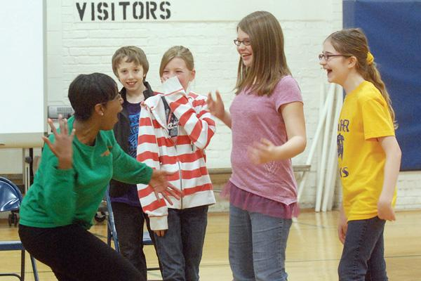 Imagination Theater improvises with student volunteers.