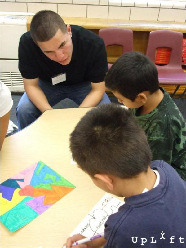 High school students mentor younger children in our In School program.