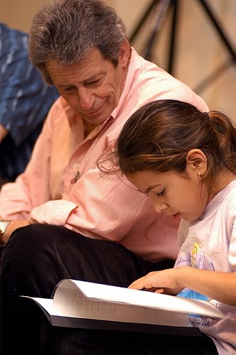 A young writer works with her mentor.