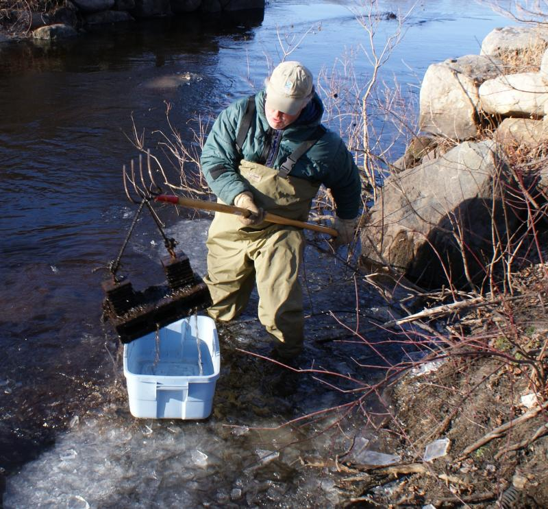 Jim chops ice to remove bug trap. Our experts keep an eye on river in snow, rain, heat or drought.