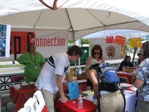 Providing information and testing at Denver PrideFest, June 2010.