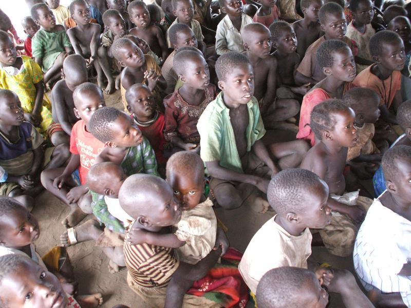 Kids in N. Uganda listening to Bible story