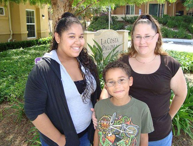 Family from La Costa Paloma apartments, an affordable CHW rental community in Carlsbad.