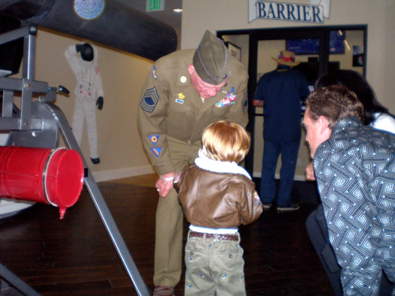 Future pilot visits with WWII veteran in the Hands-On Aviation Center