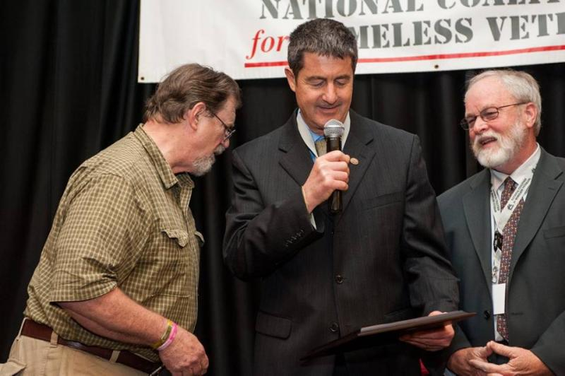Executive director Michael Blecker (center) receives the 2015 Thomas Wynn Sr. Memorial Award for Lifetime Achievement from the National Coalition for Homeless Veterans