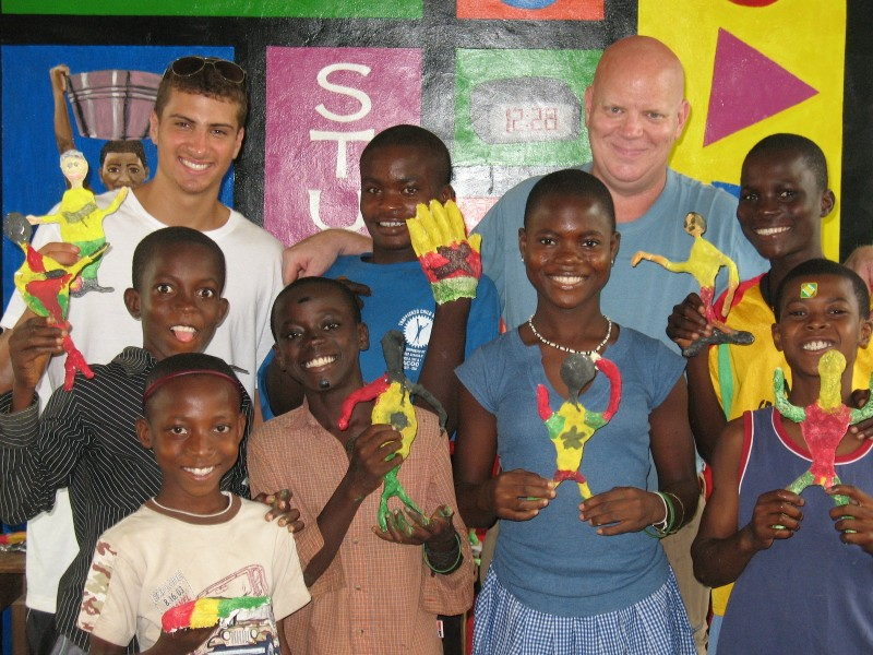 Art teacher, Michael and his students - Art Camp Ghana