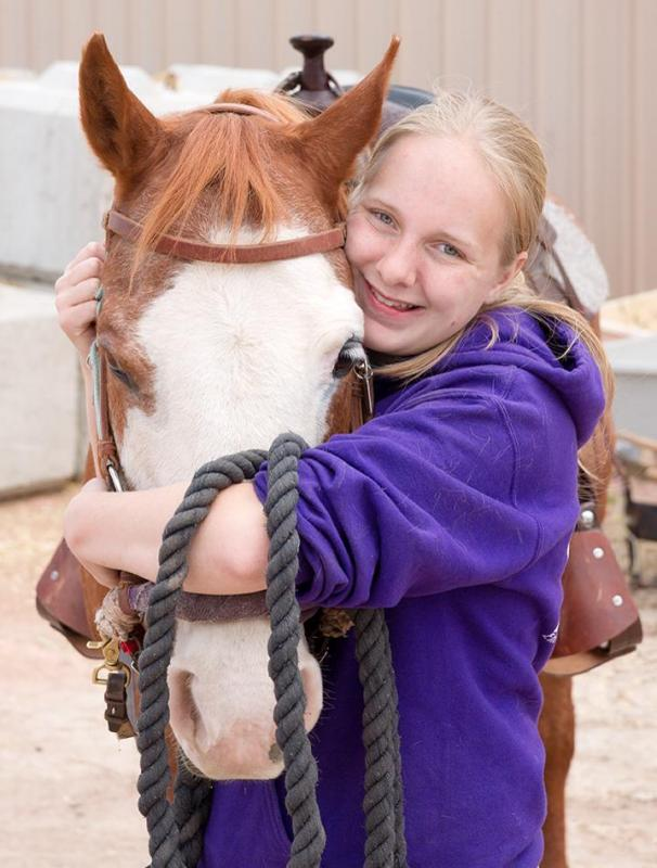 Miranda and Rebel, a wonderful volunteer and her therapeutic riding horse.